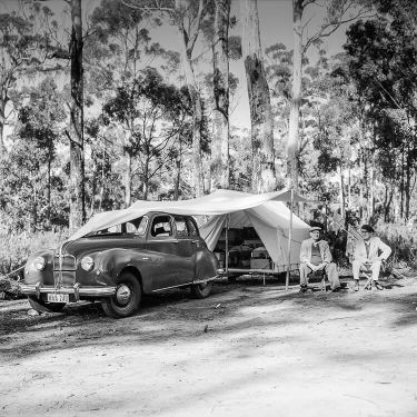 Historical photo of Alf Holding and Roy Taylor at Cloudy Bay entrance with their caravan