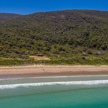 View of Cloudy Bay Cabin and the beach on Bruny Island