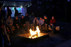 Relaxing by the outside fire at Bruny Island Lodge