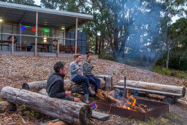 relaxing by the outdoor fire at Bruny Island Lodge